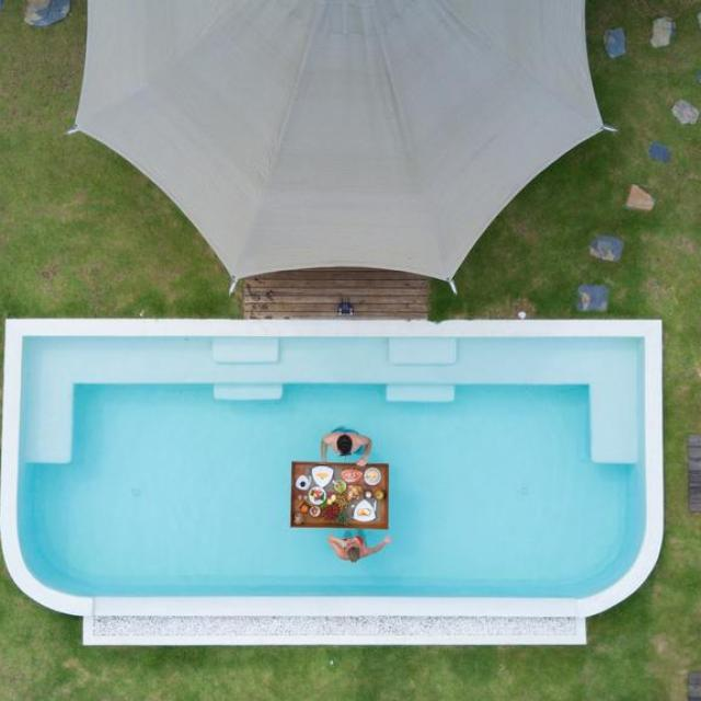 Floating breakfast with 2 people in swimming pool arial photo 9 Hornbills Adult only Glamping Koh Yao