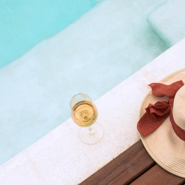 Wine glass and hat beside private pool 9 Hornbills Adult only Glamping Koh Yao