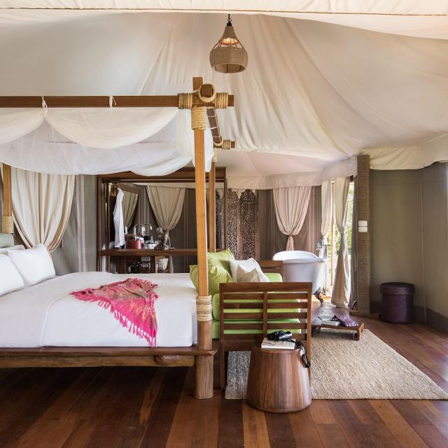 Bed and sofa inside Tent 9 Hornbills Adult only Glamping Koh Yao